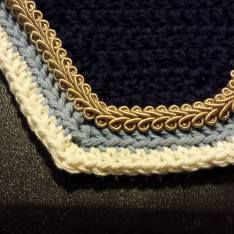 Navy, light blue and cream square front with beige scroll cord.
