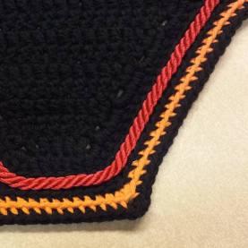 Black, orange, black with red cord.