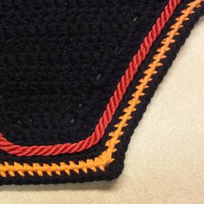 Black, orange, black with red cord.