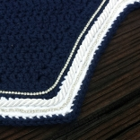 Navy, white, navy with a row of white cord and 2 rows of crystals.