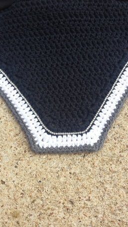 Black, white, grey with a row of size 1 crystals