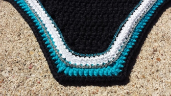 Black, turquoise, black with white scroll cord, clear crystals and turquoise crystals