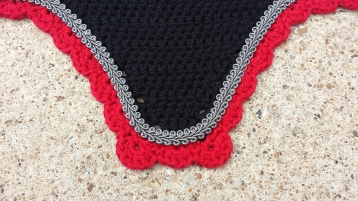 Black with red scallops with grey scroll cord